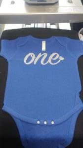 custom - one white glitter on royal blue baby one piece